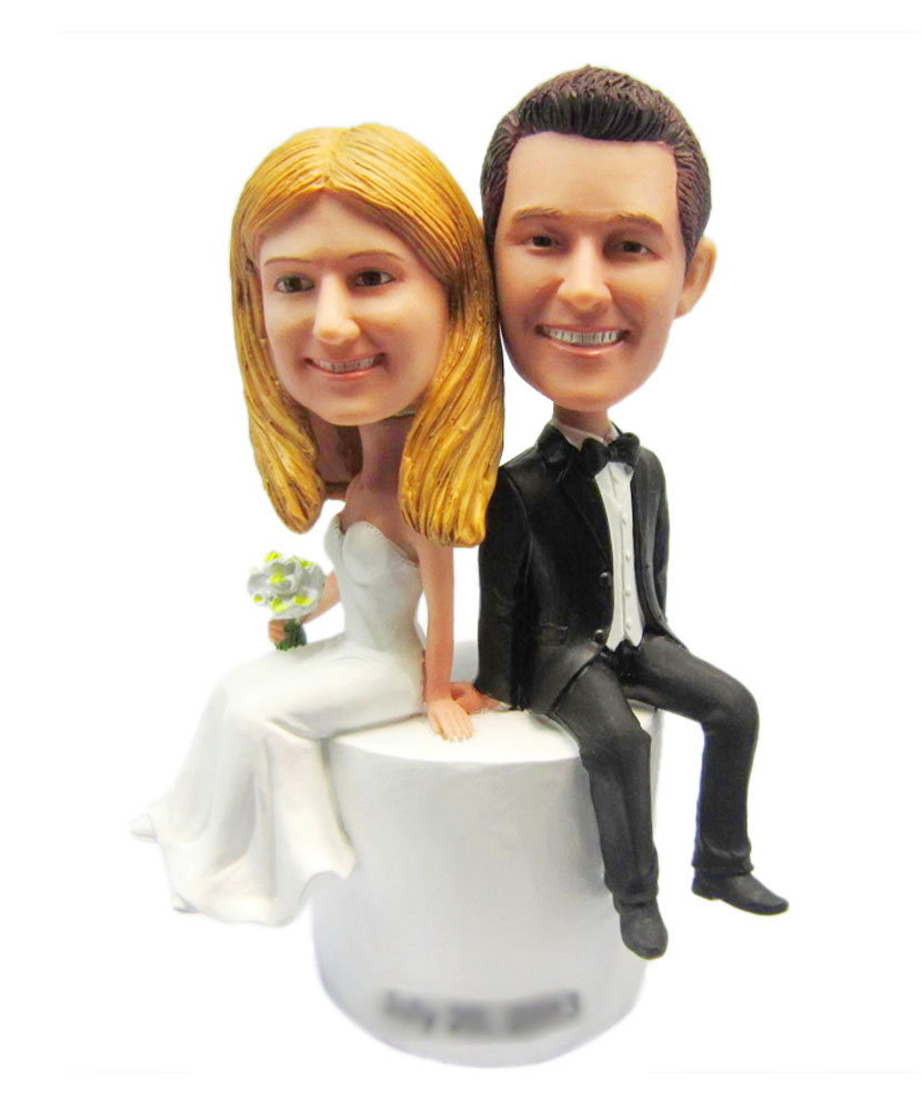 Bride and Groom Sit on Base Wedding bobblehead