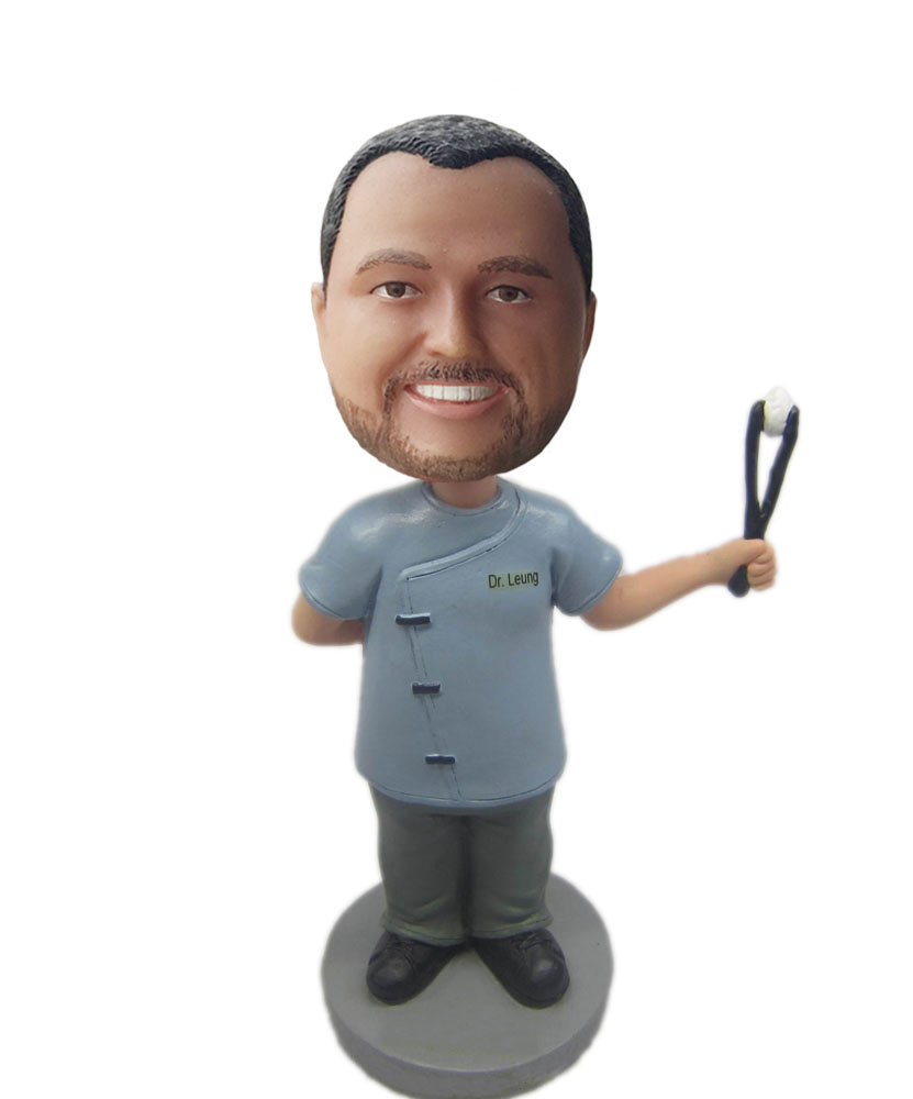 Male physician bobbleheads holding up with a operating forceps B239-1