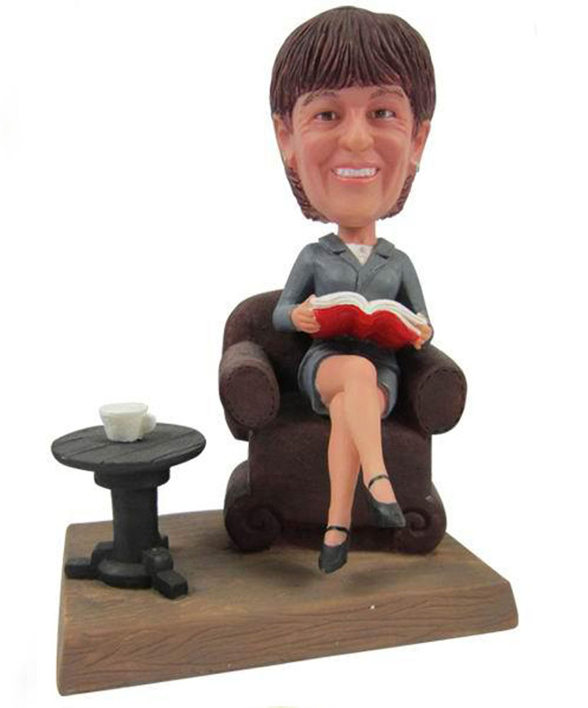 Intelligence bobblehead sitting on a chair G091