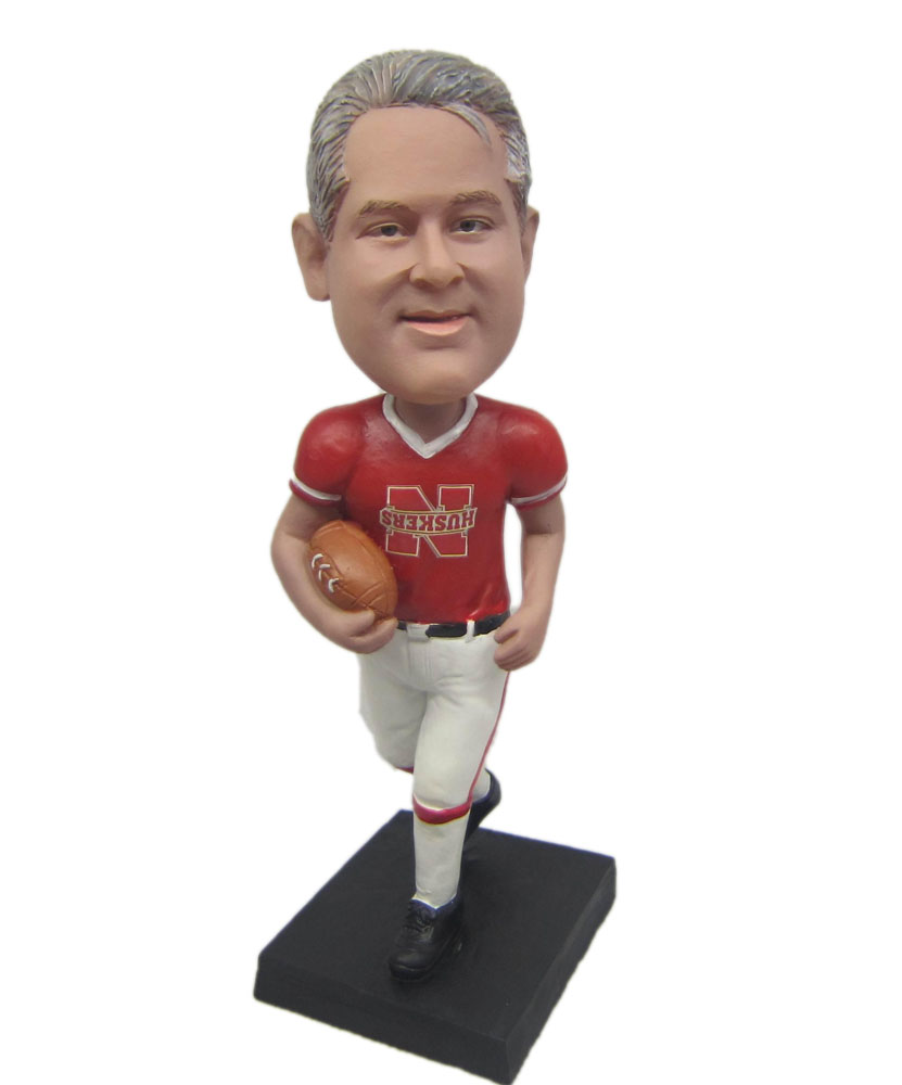 Customized bobble head of rugby player