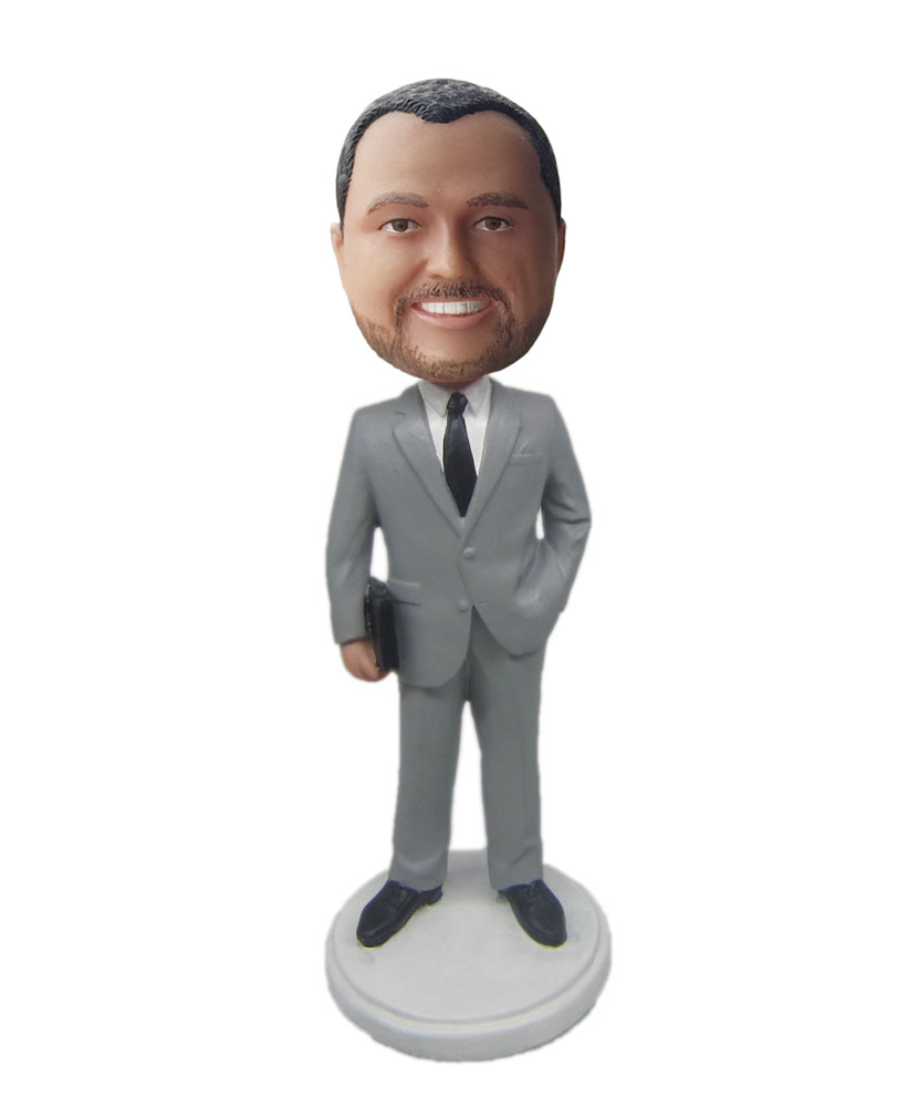 Custom made figurines dressed in gray suit