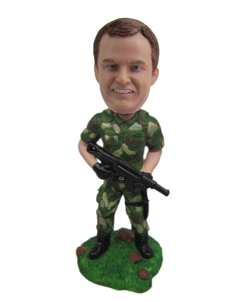 Personal bobbleheads of soldier with camouflage uniform