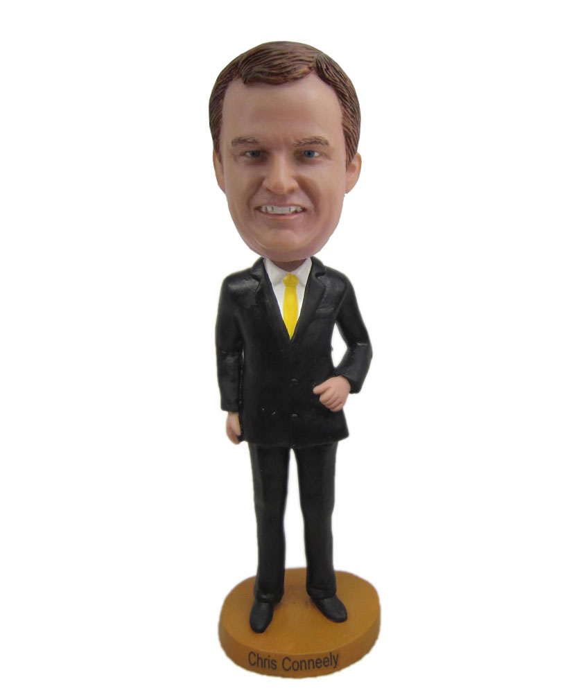 Popular bobbleheads dressed in black suit and yellow tie