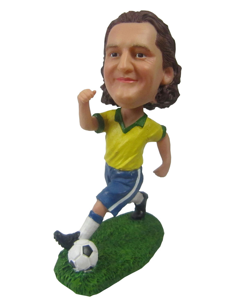 Soccer bobbleheads with yellow jacket and blue shorts