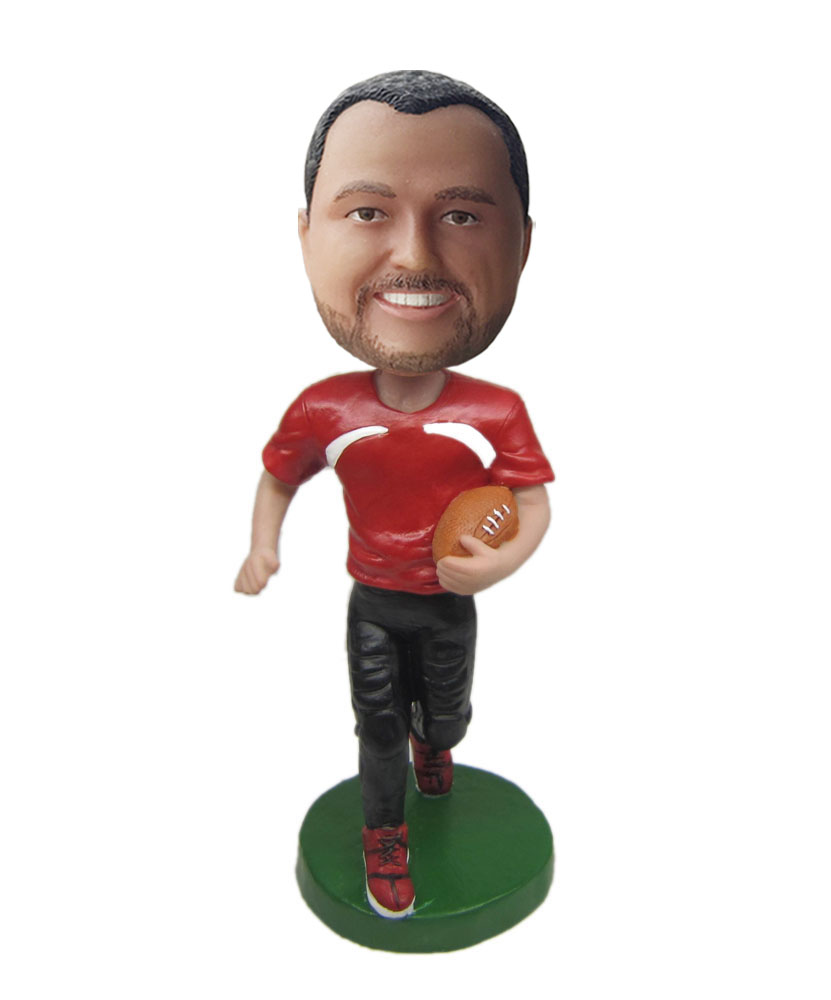Custom made bobble head of rugby player