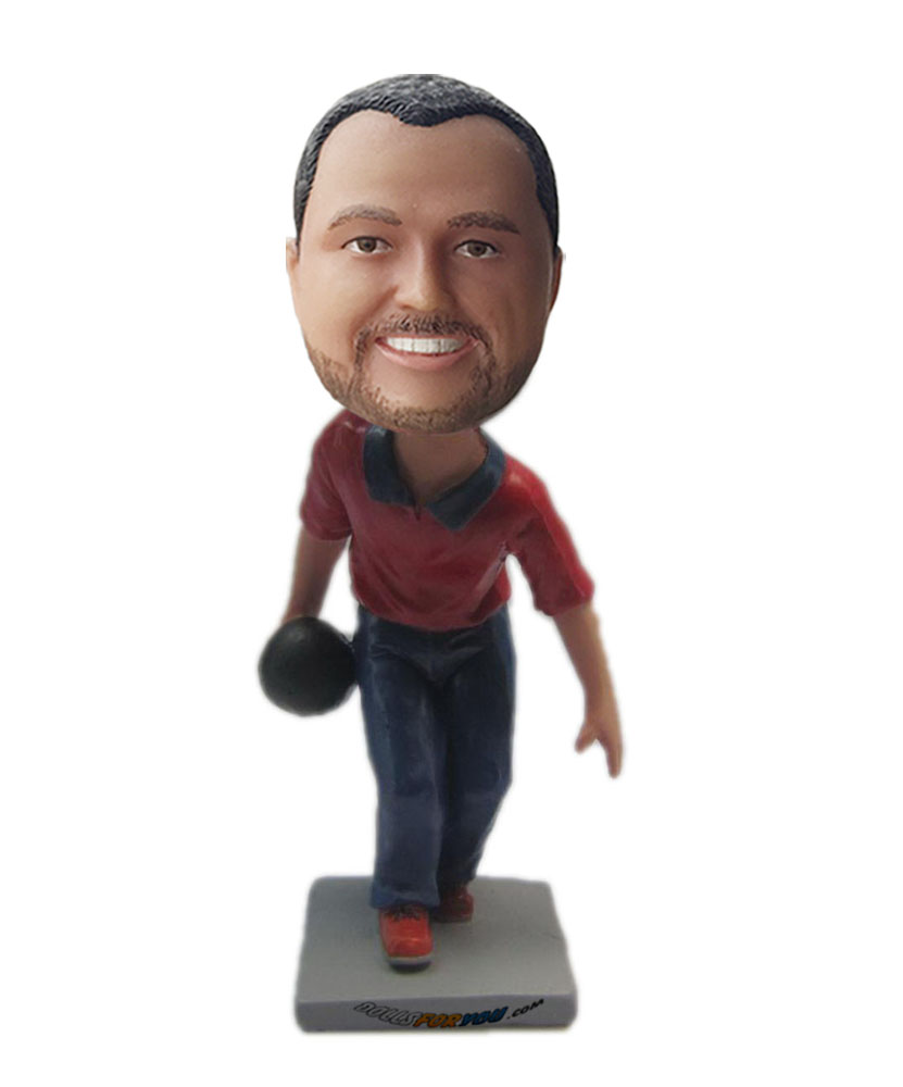 Sports bobblehead dolls holding a ball on hand