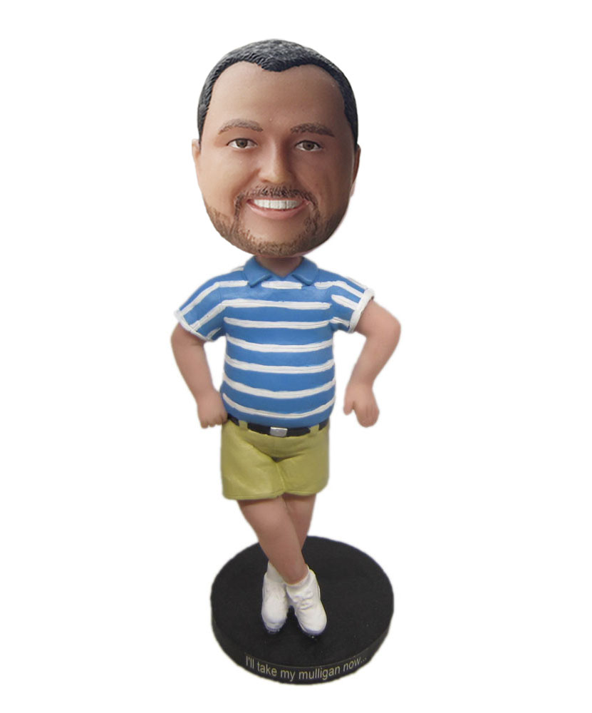 dashboard doll bobble head dressed in blue shirt and dark yellow shorts