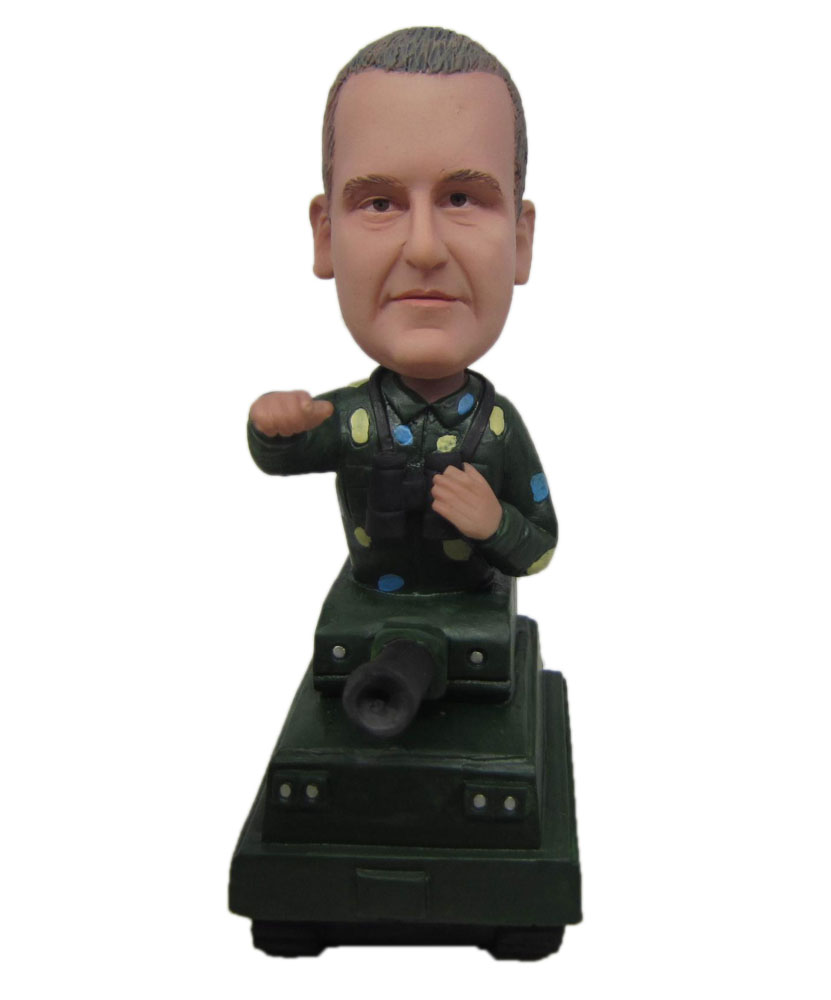 Commander bobble Head standing on a tank