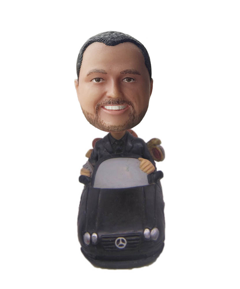Handsome guy bobblehead with benz car