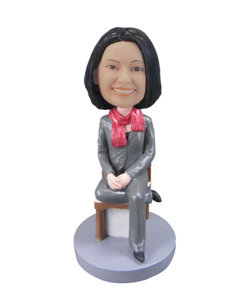 Custom bobblehead female wearing Gray suit sitting in chair F103