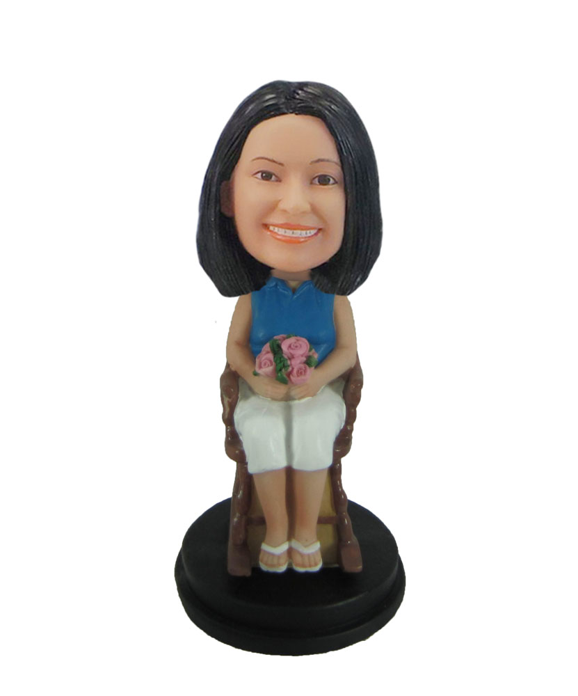 Mother bobblehead Holding flowers on the chair F124