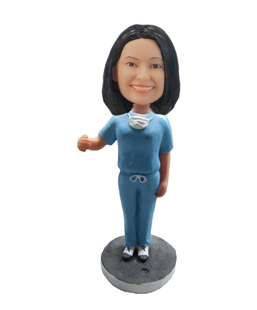 Female nurse in Blue Smiling angel bobblehead F125