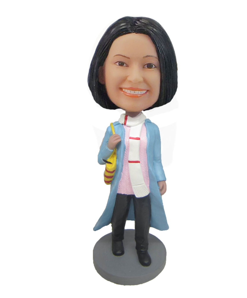 Shopping mother in blue coat bobblehead doll F825