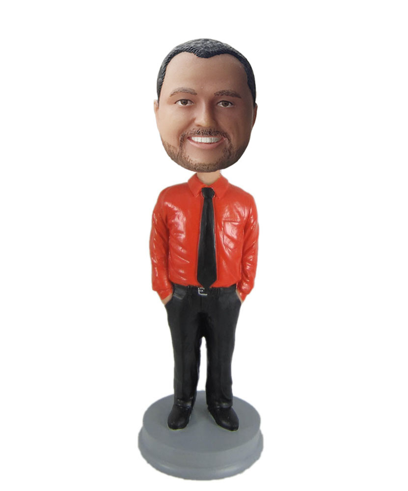 Personalized bobblehead dolls dressed in orange shirt and black trousers