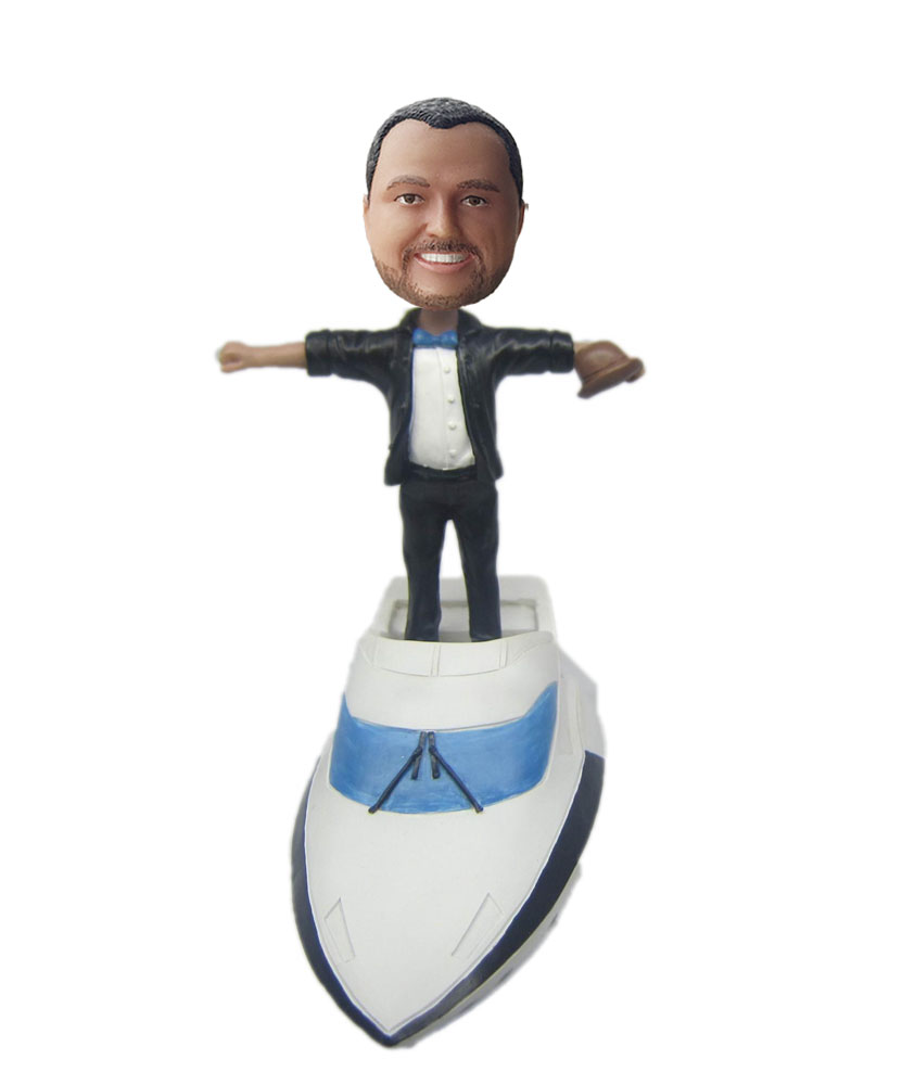 bobble head figures standing on a white yacht G206
