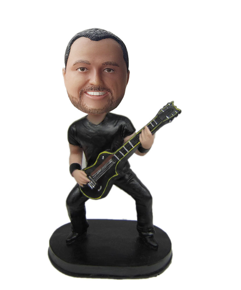 funny dashboard bobbleheads of guitar player